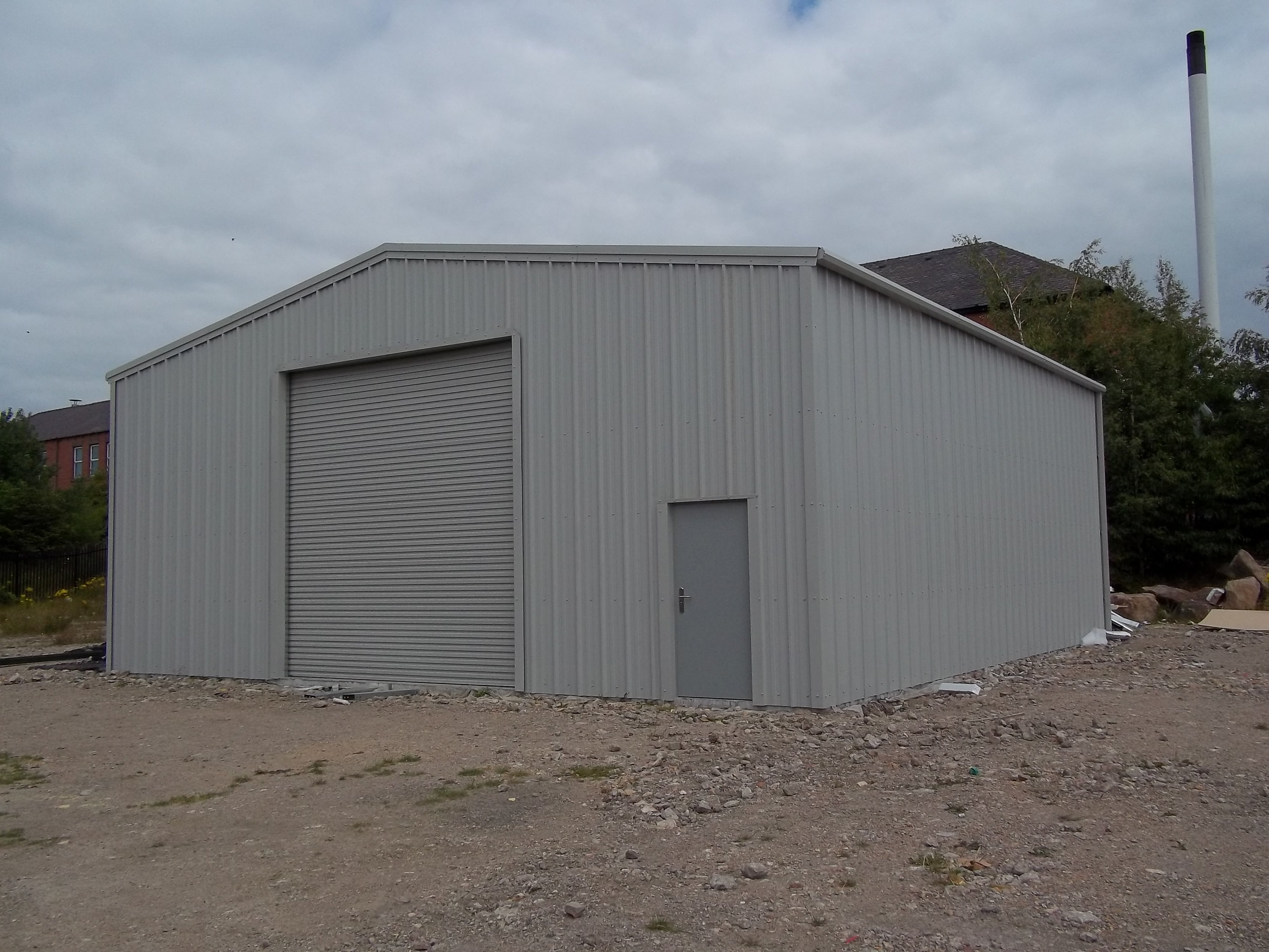 Commercial Steel Garages With An Overhand : Potteries steel buildings